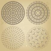 Set of four ethnic swirly round borders patterns on grunge