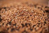 Buckwheat Pile On A Black Stone Background