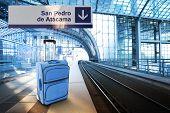 Departure For San Pedro De Atacama, Chile. Blue Suitcase At The Railway Station