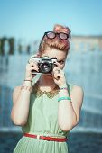 Beautiful Girl In Vintage Clothing Taking Picture With Retro Camera