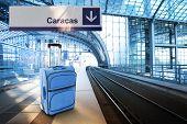 Departure For Caracas, Venezuela. Blue Suitcase At The Railway Station