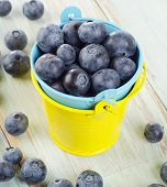 Blueberries In  Buckets On A Wooden Table.