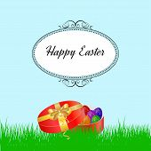 Easter background with grass and colorfull eggs