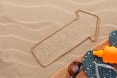 Dubai  Pointer And Beach Accessories Lying On The Sand