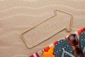 Malta  Pointer And Beach Accessories Lying On The Sand