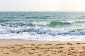 Waves on the beach white sky