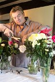 Man Arranging Flowers