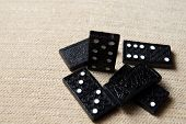 black Dominoes on nice texture colour background
