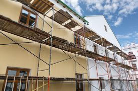 picture of reconstruction  - Old building facade with scaffolding under reconstruction - JPG