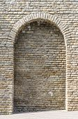 picture of fortified wall  - Medieval limestone wall with arch vertical view - JPG