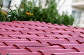 pic of red roof  - A corrugated red metal roof on a home