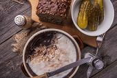 stock photo of collate  - lard with cracklings in bowl on old wooden table - JPG