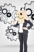 picture of anonymous  - Anonymous businesswoman sending a text against turning cogs - JPG