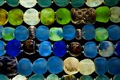 stock photo of beads  - Detail of Glass Beads in polarized Light - JPG