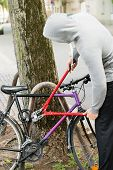 picture of pliers  - Thief Trying To Break The Bicycle Lock With Long Pliers - JPG