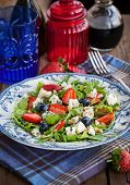 pic of pine nut  - Fresh delicious arugula strawberry blueberry pine nuts and blue cheese salad - JPG