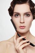 picture of razor  - Beautiful young woman with cold wave hairdo and vintage razor in her hand - JPG