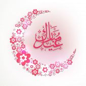 stock photo of crescent  - Beautiful crescent moon made by shiny flowers and pink Arabic Islamic calligraphy of text Eid Mubarak for Islamic holy festival - JPG