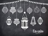 image of kareem  - Set of different traditional Arabic lanterns with bunting decoration on chalkboard background for Islamic holy month of prayers - JPG