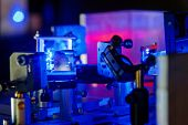 image of laser beam  - Blue laser on optical table in a quantum optics lab - JPG