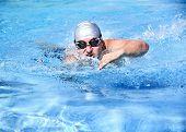 stock photo of swim meet  - Professional male swimmer swimming in the pool - JPG
