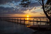 picture of jetties  - Reflections and jetty at Lake Starnberg  in the evening light - JPG