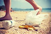 picture of environmental pollution  - Vintage instagram style picture of garbage left by tourists on a beach environmental pollution concept picture - JPG