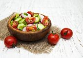 picture of radish  - Spring salad with tomato cucumbers and radish on a wooden background - JPG