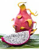 picture of dragon fruit  - Dragon fruit on banana leaf against white background - JPG