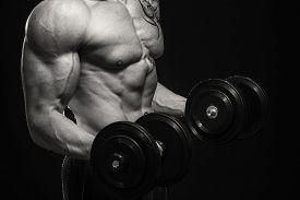 foto of bodybuilder  - Muscular man bodybuilder with tattoos - JPG