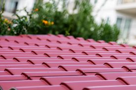 pic of red roof  - A corrugated red metal roof on a home  - JPG