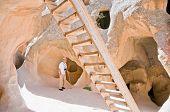 Awestruck Tourist In Monastic Cave Community In Cappadocia, Turkey