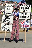 SAINT LOUIS, MISSOURI - SEPTEMBER 12: Man dressed in patriot costume holding signs at rally of the T