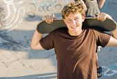 young teen boys together with skateboard on playground