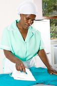 african american domestic worker ironing clothes poster