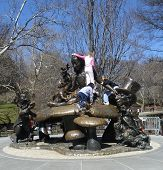 picture of mad hatter  - children playing on a statue of alice in wonderland at central park - JPG