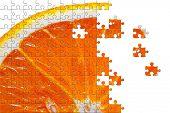 Puzzle Sliced orange isolated on white background