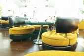 Lounge modern interior.  No recognizable faces or brandnames.