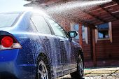 image of car wash  - Blue car washing on open air - JPG