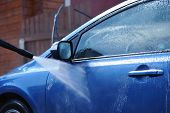 pic of car wash  - Blue car washing on open air - JPG