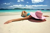 picture of beach hat  - Woman on a beautiful beach - JPG