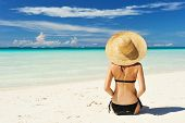 picture of woman bikini  - Girl on a tropical beach with hat - JPG