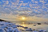 stock photo of arctic landscape  - landscape with winter sea under sky with clouds - JPG