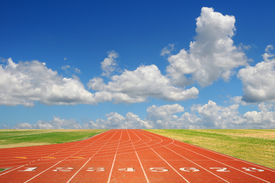 pic of race track  - Running track with eight lanes with sky and clouds - JPG