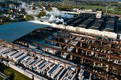 Aerial View Of Modern Large Industrial Factory, Industrial Area. Concept Of Air Pollution And Indust poster