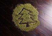 Abstract Picture Of Christmas Tree Made Of Fir Needles On Wooden Floor