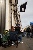 LONDON - OCTOBER 9: Consumers keen to purchase the iPhone 4S camp outside the Regent Street Apple St