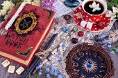 Witch Book With Magic Spellings, Black Candles, Flowers And Cup Of Tea With Zodiac Circle. Occult, E poster