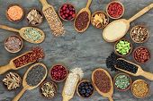 Super food with legumes, grains, seeds, berry fruit, cereals, medicinal herbs and spices, pollen gra poster