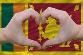 Heart And Love Gesture Showed By Hands Over Flag Of Sri Lanka